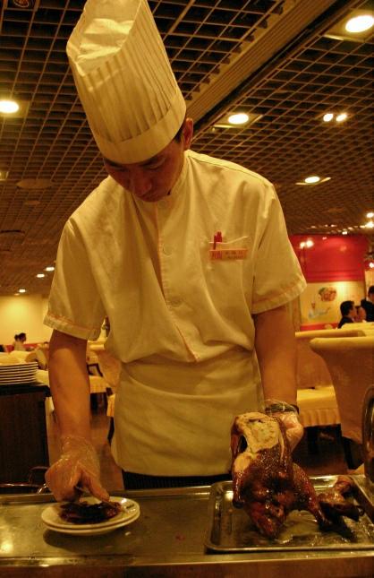 Pekingente mit Koch